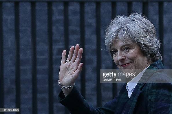 TOPSHOT British Prime Minister Theresa May waves as she arrives back at 10 Downing Street in London on January 17 after delivering a Brexit speech at...