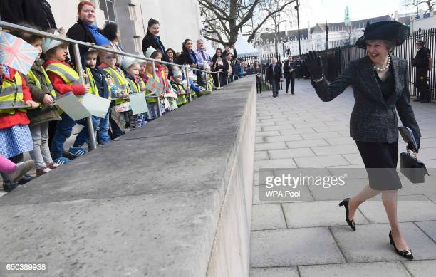 British Prime Minister Theresa May waves as she leaves after the unveiling of the new memorial to members of the armed services who served and died...