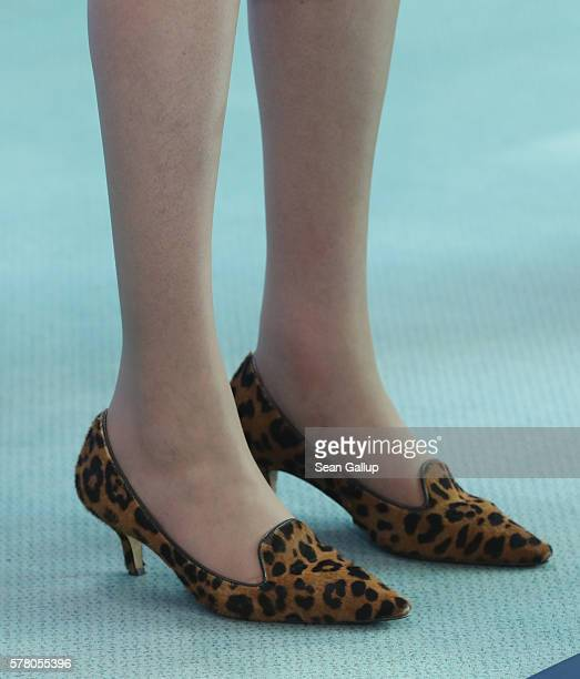 British Prime Minister Theresa May wears leopardpatterned shoes as she and German Chancellor Angela Merkel speak to the media following talks at the...