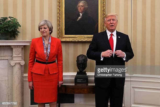 British Prime Minister Theresa May with US President Donald Trump in The Oval Office at The White House on January 27 2017 in Washington DC British...