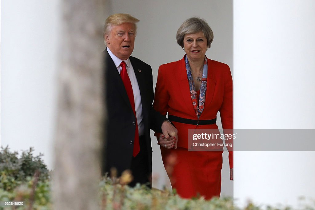 British Prime Minister Theresa May with U.S. President Donald Trump walk along The Colonnade at The White House on January 27, 2017 in Washington, DC. British Prime Minister Theresa May is on a two-day visit to the United States and will be the first world leader to meet with President Donald Trump.