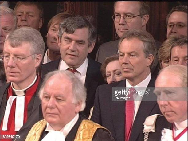 British Prime Minister Tony Blair and Chancellor of the Exchequer Gordon Brown listen as Britain's Queen Elizabeth II makes a speech in the House of...