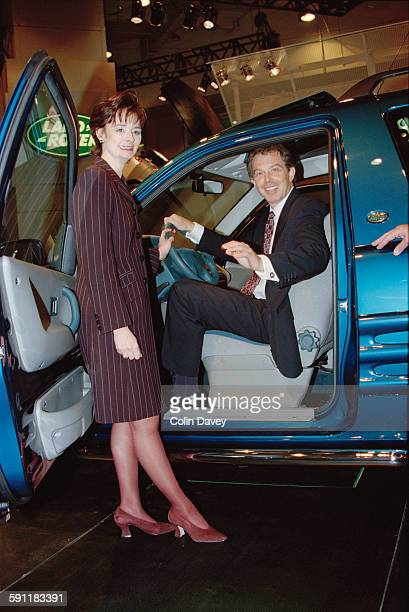 British Prime Minister Tony Blair and his wife Cherie Blair getting out of a Land Rover at the British International Motor Show in Earl's Court...