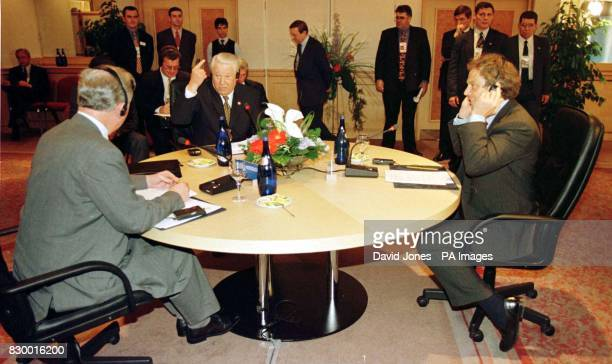 British Prime Minister Tony Blair and President of the European Commission Jaques Santer listen to a simultaneous translation over headsets of the...