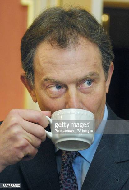 British Prime Minister Tony Blair drinks a cup of tea in London's Downing Street where he met key figures from the world of sport to discuss the...