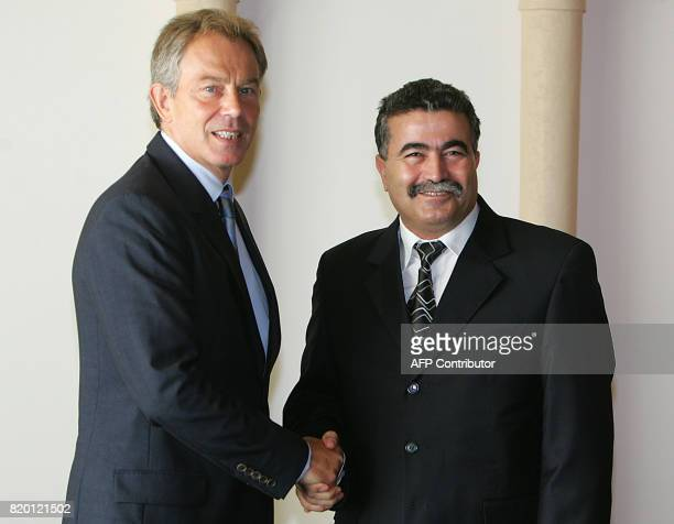 British Prime minister Tony Blair greets Israeli Defence Minister Amir Peretz prior to a meeting at the King David hotel in Jerusalem 10 September...
