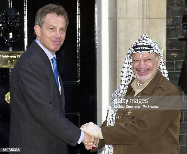 British Prime Minister Tony Blair greets Palestinian leader Yasser Arafat outside Downing Street *Mr Arafat was meeting with the Prime Minister and...