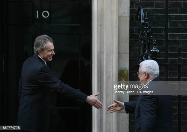 British Prime Minister Tony Blair greets the Palestinian President Mahmoud Abbas on the steps of No 10 Downing Street in central London