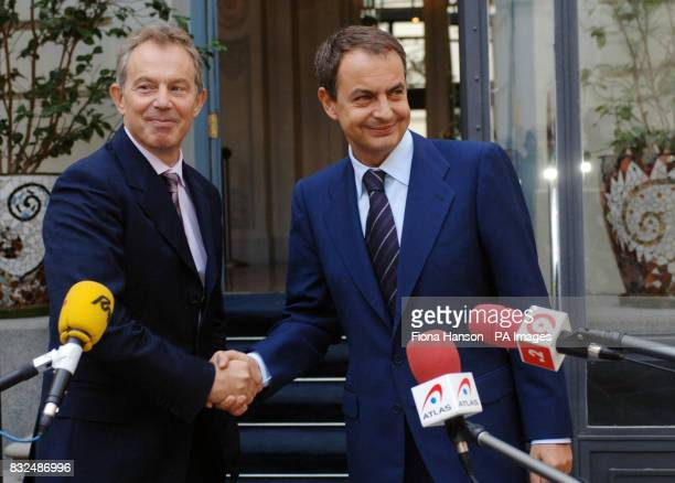 British Prime Minister Tony Blair left and Spain's Prime Minister Jose Luis Rodriguez Zapatero shake hands during a 'doorstep' news conference at the...