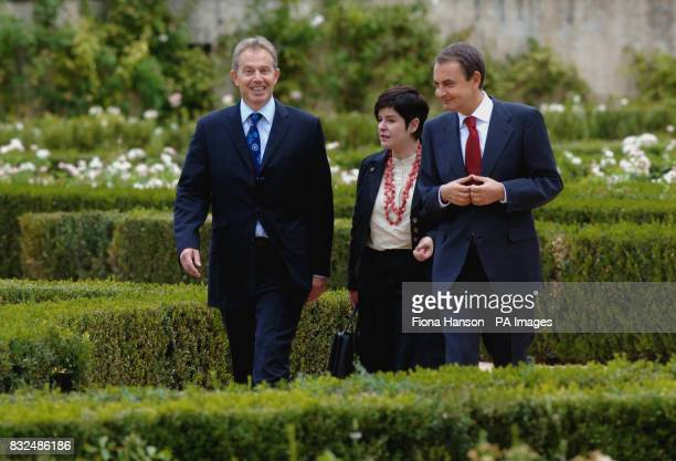 British Prime Minister Tony Blair left talking with Spanish Prime Minister Jose Luis Rodriguez Zapatero right accompanied by an interpreter after...
