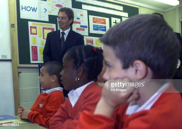 British Prime Minister Tony Blair listens to a maths lesson at Southfield Junior school Mr Blair visited the school with Education Minister David...