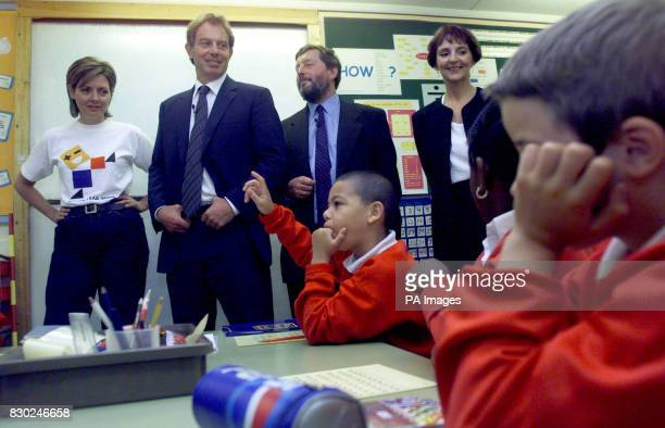 British Prime Minister Tony Blair listens to a maths lesson at Southfield Junior school Mr Blair visited the school with TV presenter Carol Vorderman...