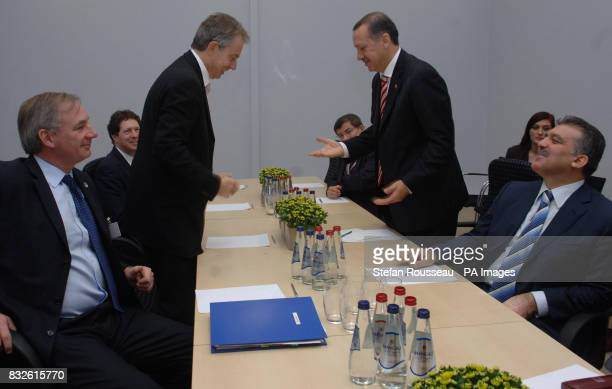 British Prime Minister Tony Blair meets with his Turkish counterpart Recep Tayyip Erdogan during the first working session of the NATO Summit in Riga...