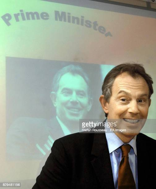 British Prime Minister Tony Blair plays a spelling game with children from Holywell School