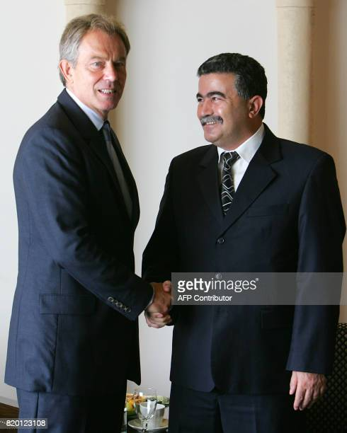 British Prime minister Tony Blair shakes hands with Israeli Defence Minister Amir Peretz prior to a meeting at the King David hotel in Jerusalem 10...