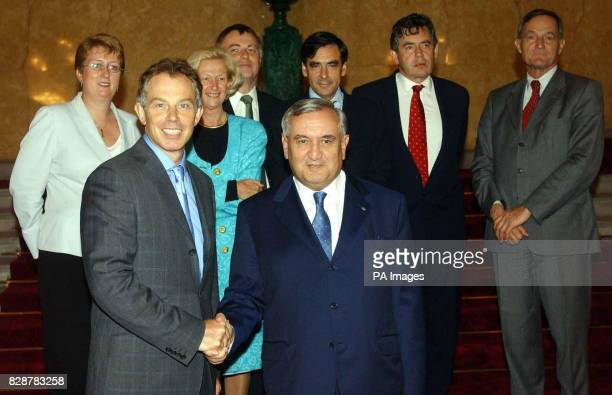 British Prime Minister Tony Blair shakes hands with the French Prime Minister JeanPierre Raffarin at reception at Lancaster House London with Jacqui...