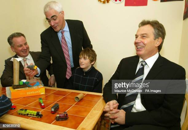 British Prime Minister Tony Blair sitting next to Paul Duff with Scotland's First Minister Jack McConnell left and the Secretary of State Alistair...