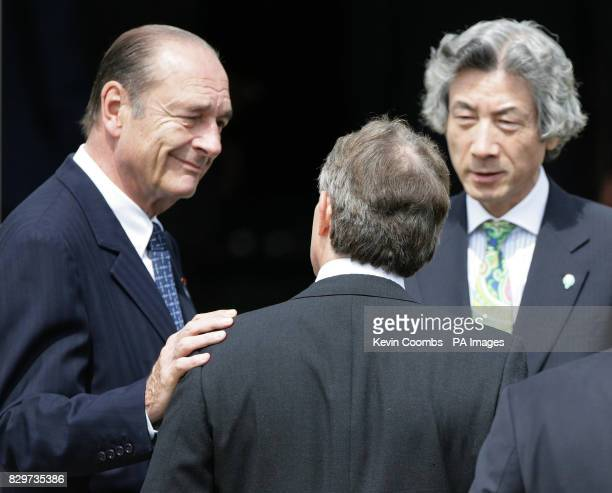 British Prime Minister Tony Blair speaks with French President Jacques Chirac and Japanese Prime Minister Junichiro Koizumi following a family photo...