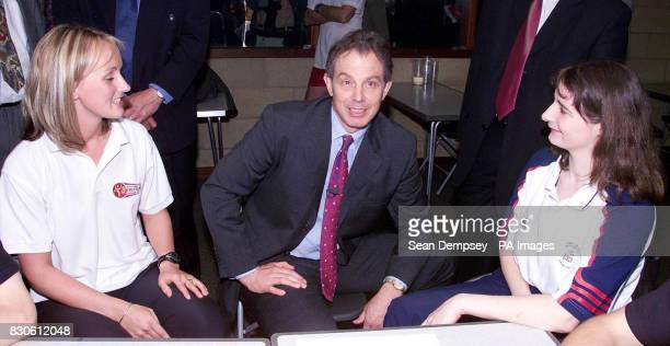 British Prime Minister Tony Blair talks to PE teacher Elizabeth Bridge and student Fiona Neale during his visit to the Burleigh Community College a...