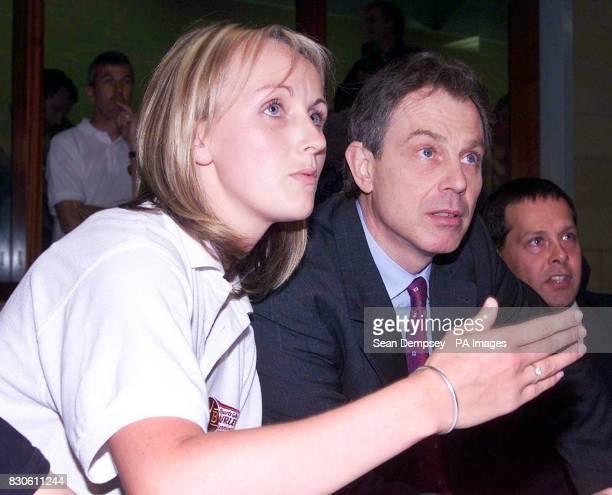 British Prime Minister Tony Blair talks to PE teacher Elizabeth Bridge during his visit to the Burleigh Community College a sport specialist school...