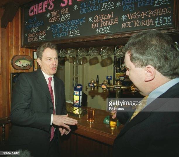 British Prime Minister Tony Blair talks with local Liberal Democrat MP Adrian Sanders during a visit to the Drum Inn Cockington Torquay He was in the...