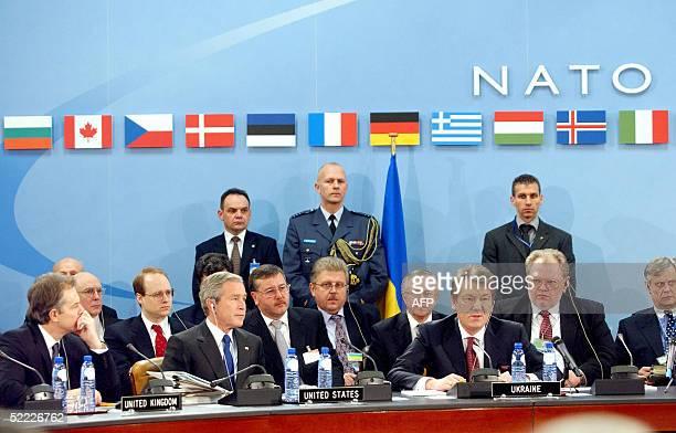 British Prime Minister Tony Blair US President George W Bush and Ukraine's President Viktor Yushchenko take part in a NATOUkraine meeting at the...