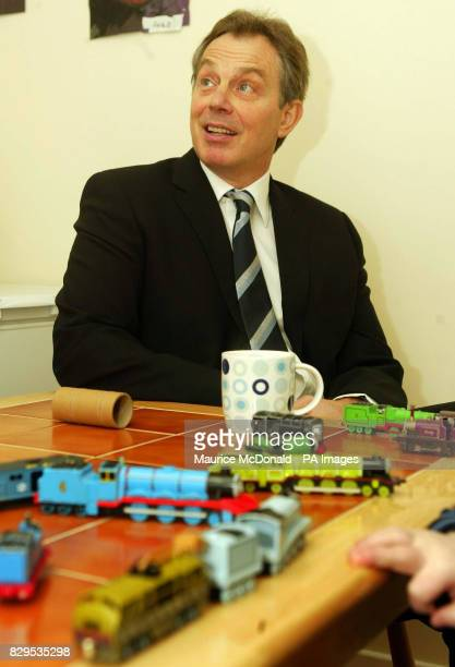 British Prime Minister Tony Blair with a small train set in front of him during a visit to the Duff family house part of a Housing Association...