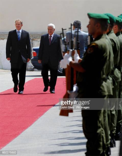 British Prime Minister Tony Blair with Palestinian President Mahmoud Abbas as they walk past a Guard of Honour of Palestinian Security forces at the...
