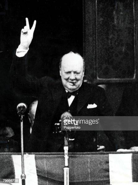 London England 8th May British Prime Minister Winston Churchill gives the famous V sign to large crowds gathered in Whitehall and Parliament Square...