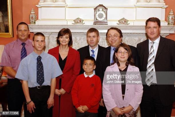 British Prime Minister's wife Cherie Blair entertains Gillingham MP Paul Clark MP with some of his local constituents Carl Preece Master Andrew...