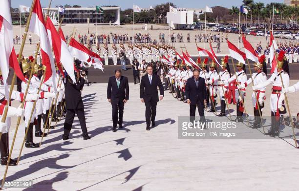 British Prime MinisterTony Blair reviews a guard of the Dragons of Independence at the Planalto Palace in Brasilia before meeting the Brazilian...