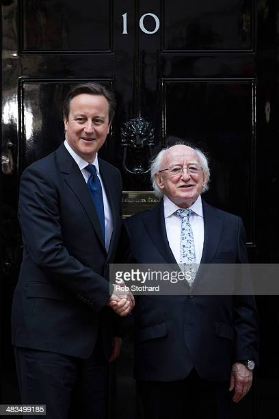 British Prime Minster David Cameron greets Irish President Michael D Higgins outside 10 Downing Street on April 9 2014 in London England This is the...