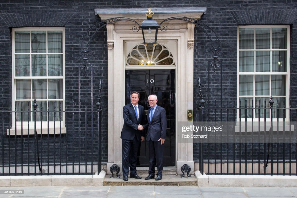 British Prime Minster <a gi-track='captionPersonalityLinkClicked' href=/galleries/search?phrase=David+Cameron+-+Politiker&family=editorial&specificpeople=227076 ng-click='$event.stopPropagation()'>David Cameron</a> greets President of the European Council <a gi-track='captionPersonalityLinkClicked' href=/galleries/search?phrase=Herman+Van+Rompuy&family=editorial&specificpeople=4476281 ng-click='$event.stopPropagation()'>Herman Van Rompuy</a> outside 10 Downing Street on June 23, 2014 in London, England. The Prime Minister is meeting with the Council President Herman van Rompuy in London to press his case against the appointment of Jean-Claude Juncker as head the European Commission.