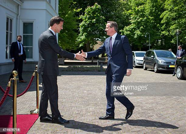 British Prime minster David Cameron is welcomed by Dutch Prime Minister Mark Rutte at the Catshuis residence on May 28 2015 in The Hague Netherlands...