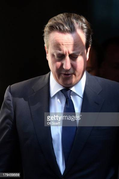 British Prime Minster David Cameron leaves Number 10 Downing Street ahead of the weekly Prime Minister's Questions in the House of Commons on...
