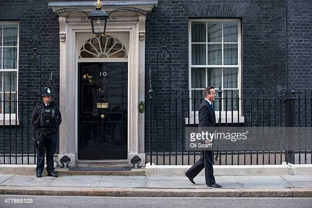 British Prime Minster David Cameron leaves Number 10 Downing Street to greet Irish Prime Minister Enda Kenny on March 11 2014 in London England Mr...