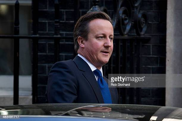 British Prime Minster David Cameron leaves Number 10 Downing Street ahead of the weekly Prime Minister's Questions in the House of Commons on April 9...