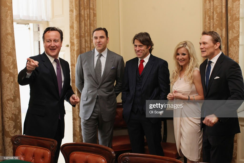 British Prime Minster David Cameron (L) meets with former England Rugby Union player Josh Lewsey (R), TV presenter Helen Skelton (2nd R) and comedians John Bishop (C) and David Walliams (2nd L) inside Number 10 Downing Street on March 30, 2012 in London, England. The four celebrities met with British Prime Minister David Cameron to discuss their individual efforts to raise money for the Sport Relief.
