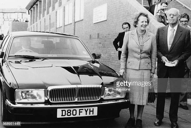 British Prime Minster Margaret Thatcher and her husband Denis Thatcher at the launch for the model of the Jaguar car October 1986