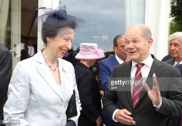 British Princess Anne arrives in Hamburg northern Germany next to Hamburg's mayor Olaf Scholz on June 15 2017 to attend a party marking the 91st...