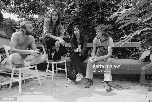 British progressive rock group Genesis 18th August 1975 Left to right Drummer Phil Collins bassist Mike Rutherford guitarist Steve Hackett and...