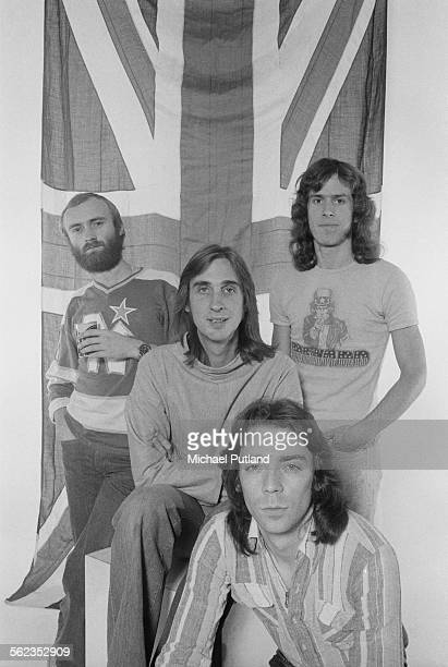 British progressive rock group Genesis posing in front of a union jack flag 4th September 1975 Left to right singer/drummer Phil Collins bassist Mike...
