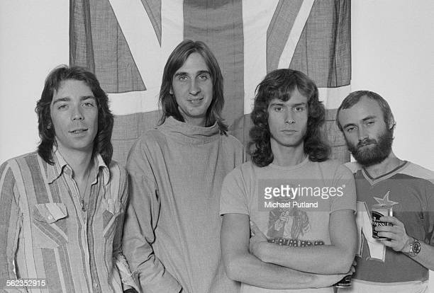 British progressive rock group Genesis posing in front of a union jack flag 4th September 1975 Left to right guitarist Steve Hackett bassist Mike...