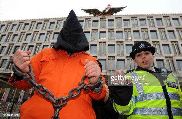 A British protester against the American detention centre at Guantanamo Bay in Cuba stages a protest outside the US Embassy in London's Grosvenor...