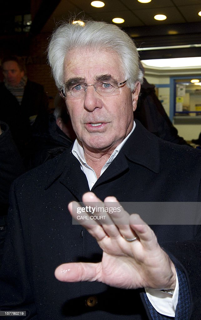 British publicist Max Clifford leaves a police station in central London on December 6, 2012 after he was released on bail following his arrest on suspicion of alleged sexual offences. Clifford on December 6 said in a statement to journalists that allegations of sexual abuse against him were 'totally untrue' following his arrest by police earlier in the day. Clifford was arrested as part of a wider investigation into sex offences sparked by allegations that late BBC presenter Jimmy Savile was a serial paedophile. AFP PHOTO / CARL COURT