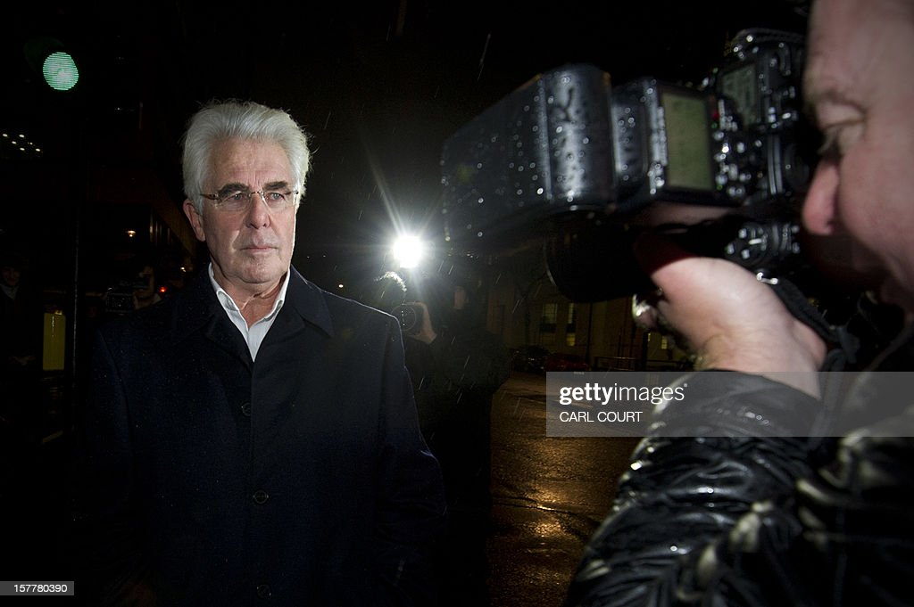 British publicist Max Clifford (L) leaves a police station in central London on December 6, 2012 after he was released on bail following his arrest on suspicion of alleged sexual offences. Clifford on December 6 said in a statement to journalists that allegations of sexual abuse against him were 'totally untrue' following his arrest by police earlier in the day. Clifford was arrested as part of a wider investigation into sex offences sparked by allegations that late BBC presenter Jimmy Savile was a serial paedophile. AFP PHOTO / CARL COURT