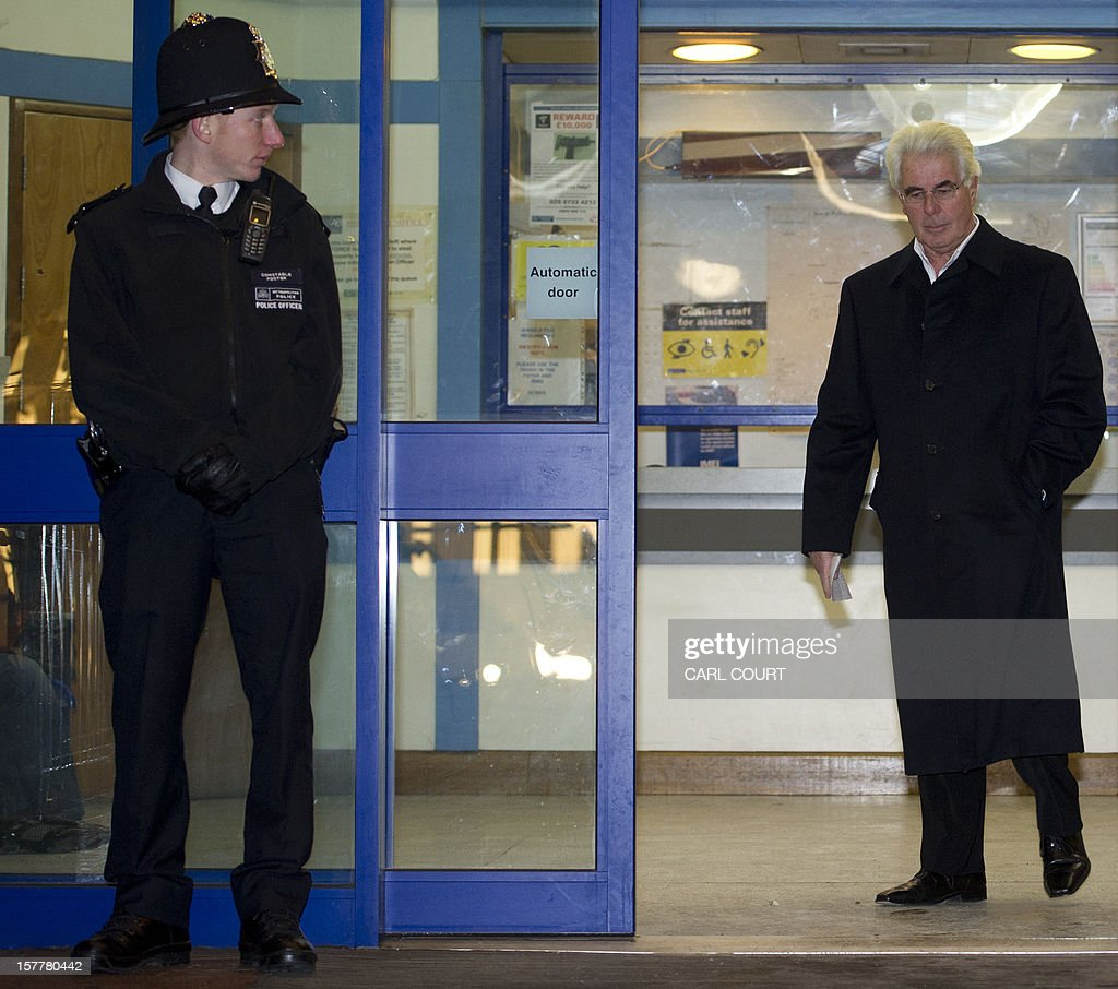 British publicist Max Clifford walks out of a police station in central London on December 6, 2012 after he was released on bail following his arrest on suspicion of alleged sexual offences. Clifford on December 6 said in a statement to journalists that allegations of sexual abuse against him were 'totally untrue' following his arrest by police earlier in the day. Clifford was arrested as part of a wider investigation into sex offences sparked by allegations that late BBC presenter Jimmy Savile was a serial paedophile. AFP PHOTO / CARL COURT