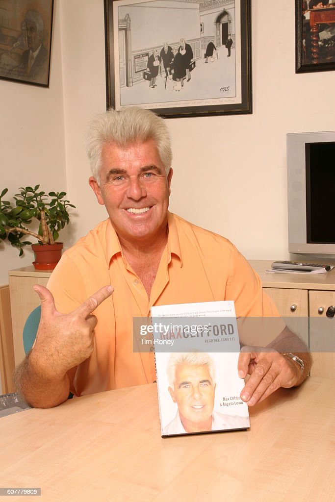 British publicity agent <a gi-track='captionPersonalityLinkClicked' href=/galleries/search?phrase=Max+Clifford&family=editorial&specificpeople=753579 ng-click='$event.stopPropagation()'>Max Clifford</a> with a copy of his autobiography 'Read All About it!', circa 2005.