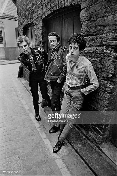British punk group The Clash in an alleyway in Central London April 1977 Left to right bassist Paul Simonon singer Joe Strummer and guitarist Mick...