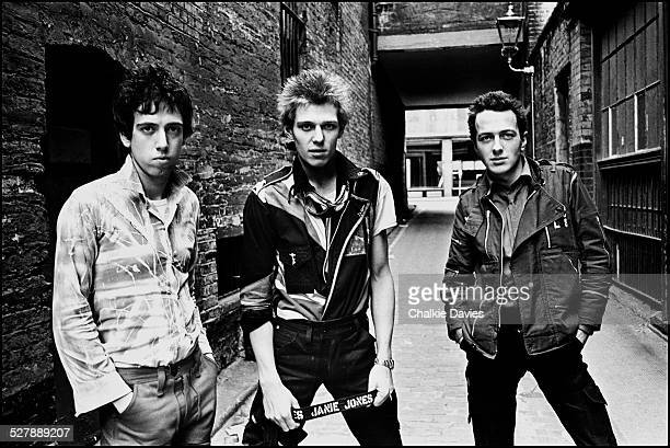 British punk group The Clash in an alleyway in Central London April 1977 Left to right guitarist Mick Jones bassist Paul Simonon and singer Joe...